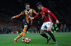 Lazar Markovic of Hull City takes on Marcos Rojo of Manchester United during the Premier League match between Manchester United and Hull City at Old...