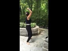 Bend arms overhead like a rainbow Qi gong exercise number 3