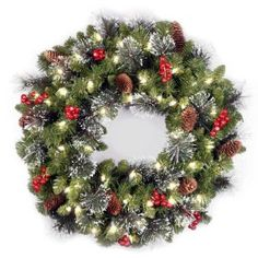 National Tree 24-Inch Crestwood Spruce Wreath with Silver Bristle/Cones/Red Berries/Glitter/50 Clear Lights  National Tree Company $41.95
