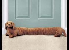 Dachshund Door Draft Stopper @ Harriet Carter It's cute, but my Doxies would shred it. Door Draught Stopper, Draft Stopper, Door Stopper, Door Blocker, Door Draft, Dachshund Art, Weenie Dogs, Door Design, Form