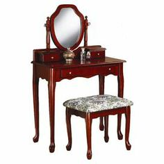 """3-drawer vanity with cabriole legs and a scrolling apron. Includes a complementing stool and attached vanity mirror.   Product: Vanity, mirror, and stoolConstruction Material: Wood, mirrored glass, and fabricColor: CherryFeatures: One large and two small drawers in vanityDimensions: Vanity: 48"""" H x 30.25"""" W x 15.5"""" DStool: 17.25"""" H x 19"""" W x 15"""" D"""