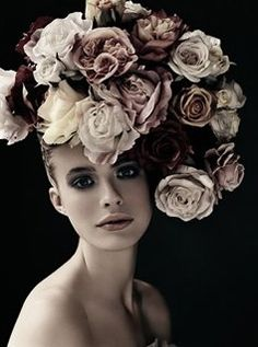 This is a photo by Irvin penn a fashion photographer, i like this piece because the model and the flowers really contrast with the black background,and some of the roses on her head actually blend into the background, its a really beautiful piece.