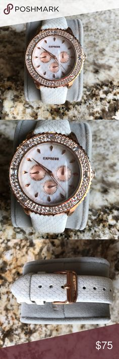 EXPRESS Women's Rose Gold Watch ⌚️ EXPRESS Women's rose gold watch , I bought this watch at a EXPRESS store in Florida and it came without box , I took all the tags a put it in my watches box but never got to wear it so the battery ran out so it will need a new battery , it has no damage because its NEW , letters straps , between 39-42 mm , round shape with crystal all around, adjustable straps Express Accessories Watches