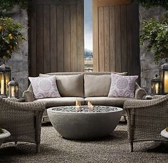 Consider using river rock base in seating area inside fence.  BTW, I love this river rock fire pit!