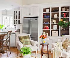 This combo kitchen and sitting room makes the most of every square inch of space, thanks to a savvy remodel. The old kitchen was closed off from an adjacent, unused addition. Removing the wall between the spaces created an op