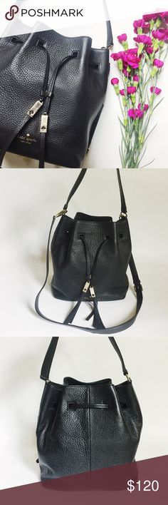 """Kate Spade Grey Street Cooper Bucket Bag Kate Spade Grey Street Cooper Bucket Bag in black featuring gold tone hardware. Pebbled leather in a casual, structured shape. Short handle and adjustable/removeable longer strap.Pre-loved but in excellent condition. Hardware shows scratches, see pics. No other damage. Leather in like-new condition. Dustbag included. Last pic stock photo, used to show fit. Authentic, no trades.    Measurements: 13"""" W x 10.5"""" H x 6.5"""" D Handle drop: 8.5"""" (short) / 22""""…"""