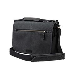 4054543f75fc The Tenba Cooper 13 Slim Messenger Bag holds a mirrorless camera with  lenses and accessories as well as a laptop up to 13 inches.