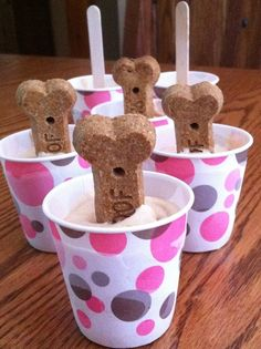 Recipe for FROSTY PAWS !! (3) 6 ounce containers of plain Greek yogurt 1 cup peanut butter 1 tablespoon honey 1 small jar of banana baby food OR you can mash up one banana instead  Mix all together until creamy Spoon into small paper dixie cups Insert popsicle stick or favorite bone treat into centers Freeze overnight....
