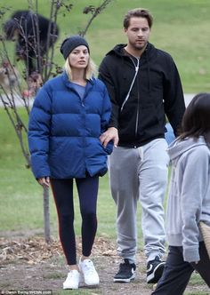 Smitten: Margot Robbie looked closer than ever to husband Tom Ackerley as the pair enjoyed a romantic stroll through West Hollywood's Pan Pacific Park on Friday