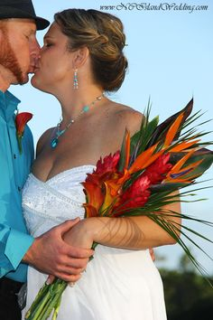 Tropical beach bouquet, red ginger, orange calla lily, birds of paradise, Island wedding. wedding photography. Wedding planning