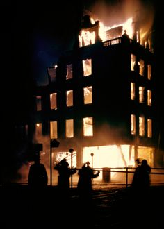 William Vandivert—Time & Life Pictures/Getty Images.  A London building ablaze during the Blitz, 1940.