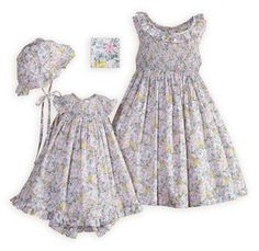 Botanical Gardens Matching Hand-Smocked Sister Dresses Tiny florals in hues of pinks, blues and greens set against a pale pink background create these beautifully hand-smocked sister outfits in an ultra-soft and lightweight cotton/poly blend