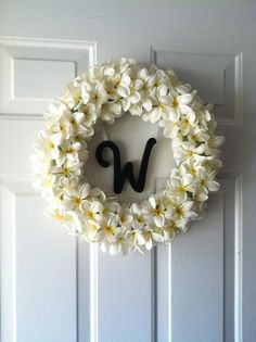 Maile (Plumeria) flower wreath for our front door! literally took me 30 min to make :)