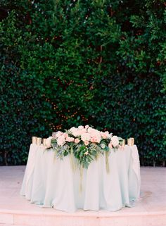 flower arrangement for sweetheart table or head table.