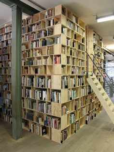 I totally want a room inside of my library where I can crawl in, pull up the ladder, and read. Epic. *Shh! Don't tell anyone, but I might have to rearrange the local library to make this!*