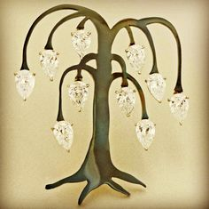 Diamond and steel tree brooch. Sotheby's Diamonds by James de Givenchy. #taffinjewelry #taffin #jamesdegivenchy