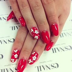 Red nails with white flower accent nails