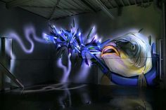 Wall painting by Bane. Love the lightpainting photography of it as well - Discover more Street Art at www.UrbanArtNow.com - #StreetArt #UrbanArt #Graffiti #Mural