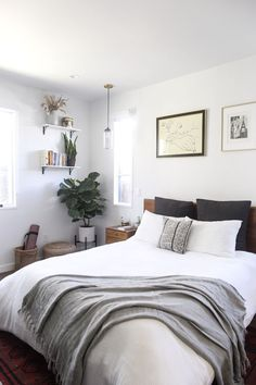 Neutral, midcentury modern bedroom with fiddle leaf fig and oak headboard. We love Jessica's red Moroccan rug and shelves where she displays pampas grass, a snake plant and books. The art above he Romantic Bedroom Decor, Stylish Bedroom, Cozy Bedroom, Master Bedroom, Master Suite, Bedroom Brown, Kids Bedroom, Bedroom Simple, Bedroom Rustic