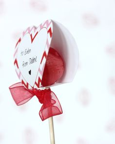 This craft is shown with lollipops, but we think this would be a great way to gift Valentine's Day cake pops as well. For delicious treats and sweets recipes for Valentine's Day, check out http://www.simplycreate.com/.