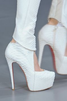 christian louboutin.white(possible alligator/snake skin)ankle boots..LOVE!!
