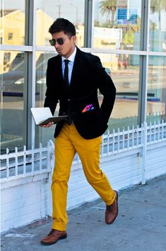 Try teaming a black sportcoat with yellow chinos if you're going for a neat, stylish look. Elevate this ensemble with brown leather derby shoes. Shop this look for $178: http://lookastic.com/men/looks/blazer-and-dress-shirt-and-tie-and-chinos-and-derby-shoes/95 — Black Blazer — White Dress Shirt — Black Tie — Yellow Chinos — Brown Leather Derby Shoes