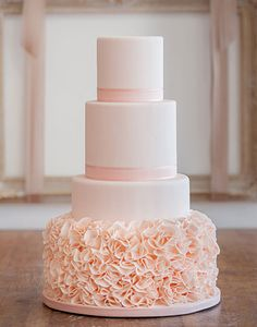 soft and romantic wedding cake design with peach ruffles