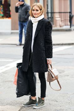 Olivia Palermo | oversized cream beige turtleneck sweater + black fur coat + leather pants skinny jeans + dark green sneakers + shoulder bag