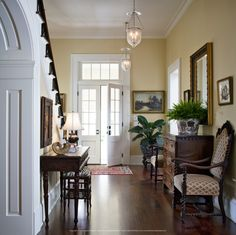 Column Detail And Wrought Iron Banisters On Cozy Porch And Large White Columns On New Orleans Inspired Home Designed By Kevin Harris Architect Llc