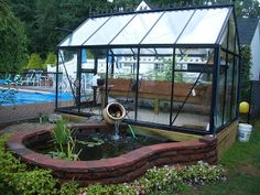 Back Yard Garden Pond and Green House designed together to support an Aquaponic Green House system