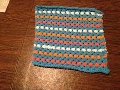 Teal, white, salmon & orange star stitch