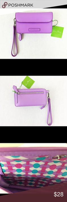 """Vera Bradley Lilac purple faux leather wristlet 6"""" w x 3 ¼"""" h x 1 ¾"""" d with 6"""" removable wrist strap all-in-one Smartphone Wristlet. Holds an iPhone 6 or similar size phone. One compartment holds a phone. Inside, six card slips, a bill compartment and an ID window, plus two slip pockets. The exterior also features a zip coin compartment. Faux leather Larger all-in-one phone case and wallet Accommodates an iPhone 6 Zip-around and pin-snap closures Zip compartment on exterior Wristlet strap…"""
