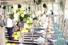 Love the stripes. Navy and white stripes with oranges as decorations would be great for a summer wedding