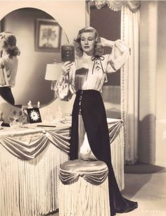 Ginger Rogers checks her hairdo in a moon-sized mirror
