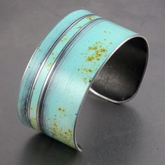 """Cuff Bracelet Made using vintage automotive steel, this cuff was made from a 55 Ford Fairlane. The color is the original Blue car paint left intact while the design was hand etched into the metal.    The cuff measures 1 1/4"""" wide. The steel can be easily adjusted to fit most wrist sizes."""