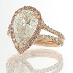 I like to think I'm not materialistic, but holy shit.   4.11 Pear Shape Diamond Engagement Anniversary Ring: Mark Broumand