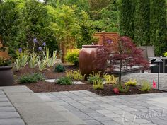 Foliage textures and colors work with the fountain and new patio