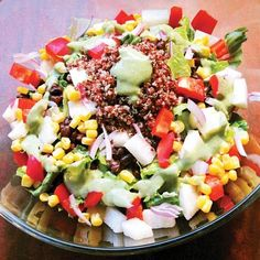 Ingredients (Makes 1 serving):  2-4 cups chopped romaine lettuce or leafy green of choice  1 serving red quinoa cooked and chilled (1/4 cup dry)  ½ cup black beans  ½ cup corn  ½ cup jicama, sliced  ½ cup red pepper, chopped  1 small tomato, chopped  2 Tbsp red onion, diced    Click link for more great protien filled salads- all vegan!