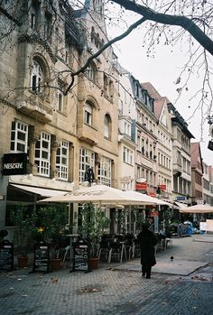 A small street in the Alstadt with cafes and shops. Stuttgart, Germany 2006 (By albany_tim)