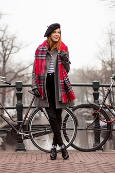 @redsonjablog braves the Amsterdam chill in a striped top and gray coat from H&M. Photo by Ellen Oudejans. | H&M OOTD
