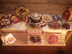 12th Scale Dolls house miniatures.  Gingerbread Christmas Counter. Handmade Artisan Counter; Artisan Gingerbread; Cakes and Biscuits.  #12thscale #miniature #dollshouseminiatures #dollshouse #dollhouse #miniaturefood #gingerbread #christmas #bakery #bakerycounter