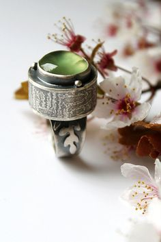 The Joy of Tropism (sterling silver and prehnite. UmberDove via Flickr)