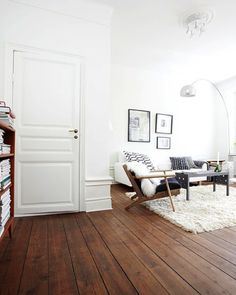 White Stained Wood Walls | Love the dark stained floors with the white walls and graphic patterns ...