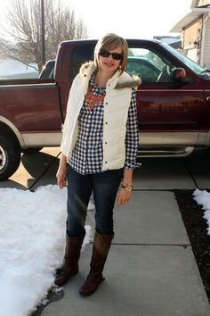 Blue gingham, white puffer vest, orange statement necklace, brown riding boots