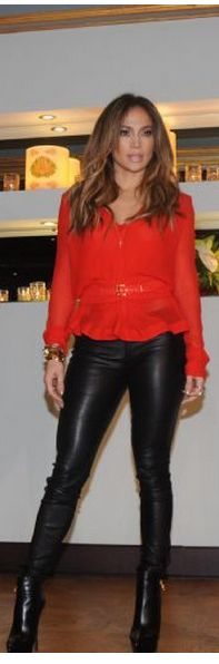Who made  Jennifer Lopez's black boots, jewelry, and red long sleeve top?