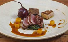 A menu highlight is gorgeous duck breast with seared foie gras, alongside beets and a crisply pressed square of confit leg meat. (Akira Suwa / Staff Photographer)