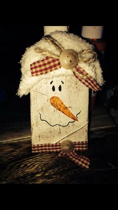 Toilet paper snowman ornaments.