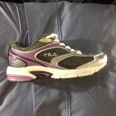 "Fila DLS Artifice sneakers size 8 M Purple and gray women's athletic sneakers by Fila, size 8 M.  Insole is approx. 10"" long.  Style name is DLS Artifice.  Material of the uppers is partially genuine leather and partially synthetic, with mesh detailing in between.  Silver accents throughout.  Brand new in box.  ⚠️ PRICE FIRM ⚠️ Fila Shoes Athletic Shoes"