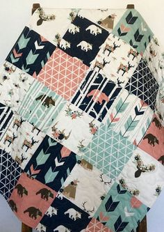 Baby Quilt, Baby Girl Quilt, Woodland Baby Quilt, Stag Baby Bedding, Bear Baby Baby, Baby Girl Blanket, Crib Bedding, Baby Bedding,Children. This adorable navy/pink/coral/aqua woodland quilt has been made with fabrics designed just for my shop.  I professionally designed, pieced and free motion quilted the entire quilt from my home sewing machine using a large loopy pattern throughout. Quilting adds texture and depth, making it stand out from a regular blanket. I also made this quilt…
