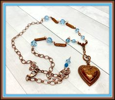 Forget-Me-Not Gingerbread pewter heart with Treble Clef and flower blue Swarovski crystals and a copper chain. Leaf Necklace, Necklace Set, Treble Clef, Filigree Ring, Gold Flowers, Gold Chains, Pewter, Gingerbread, Swarovski Crystals